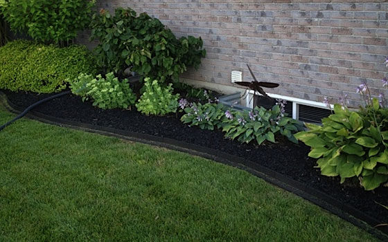 Natural looking rubber mulch and landscape edging